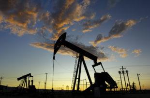 Cymric Oil Field pumpjacks against a sunset sky.