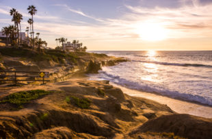 People enjoying sunset on La Jolla Beach, California, USA